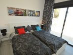 Two single beds with shared en-suite bathroom, a/c and ceiling fan