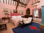 The Master Bedroom is full of light and has fantastic views across the gardens.