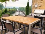 Large table, extra chairs if needed, panoramic river & castle views, Gas BBQ, next to kitchen door.