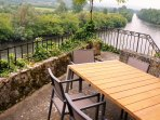 Dining terrace with extendable table for 10 people. Gas BBQ. South facing, river & 4 Chateaux views