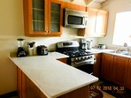 State of art kitchen with all appliance s and utensils that would be found at home.