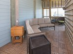 Enjoy shade and cool breezes on screened porch next to the pool.