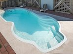 Private pool has built-in seats to cool off on hot summer days.
