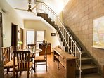 Stairs to upper two bedrooms  providing a beautiful atrium view of the dining area.