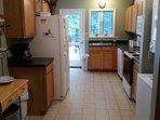 Full kitchens upstairs & downstairs w/modern appliances: 2 door fridge, w/d, etc