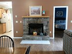 Wood burning stone fireplaces w/ solid wood mantels both upstairs and downstairs