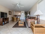 Your spacious living area with ceiling fan, A/C, and entertainment center.