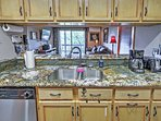 These granite countertops provide the perfect space to chop up ingredients.