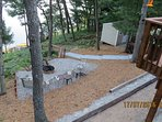Better view of Fire pit. Regulation horse shoe pit, 60 ft. patio and more