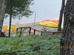 Kayaks, canoe, paddle board, tether ball on shore and in water w/ volleyball