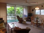 Living room and view to lanai and gardens
