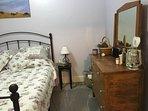 Bedroom one with queen bed
