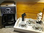 Coffee lovers will appreciate the Cuisinart Extreme Brew machine and gourmet coffee provided.