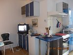 Fully equipped kitchen and TV
