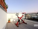 There is a spinning bicycle for those who want to do exercise.
