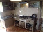Fully equipped kitchen including five ring hob, oven dishwasher, coffee machine