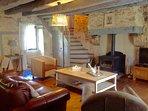 Gite sitting room, with long burner and full central heating for Winter breaks