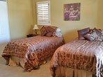Bdrm 5-Twins can convert to 1 King. Egyptian Cotton sheets, Dresser, Chair, Flatscreen HDTV.