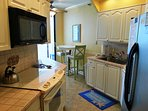 Fully equipped kitchen with a breakfast area Enjoy your meals on the patio with beautiful Gulf Views