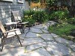 flagstone patio in back garden