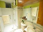 Nice bathroom with glass enclosure.