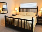 Guest bedroom  - includes closet, dresser, TV, and rim views
