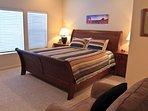 Master bedroom - en suite double-sink bathroom, TV,  and walk-in closet