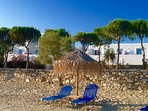 Umbrella & sunbeds on the beach directly in front of your studio