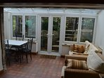 Conservatory with dining area, comfy seating and TV