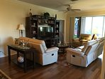 Leather reclining sofa, loveseat and recliner in family room with 55 inch Sony HDTV and BluRay