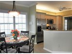 Kitchen Nook and Kitchen with all stainless steel appliances