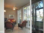 Screened lanai - gorgeous views and shade from large oak trees. External sliders convert to A/C area