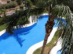 Balcony View of one 3 excellent, well-maintained pools in the private complex, with great views.