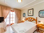Bedroom 3 with Queen size bed, balcony, pool view, tv and aircon