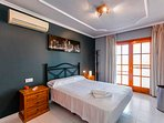 Bedroom 2 with Queen size bed, balcony, old town views,flat screen tv and aircon