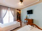 Bedroom 4 with 2 single beds, balcony, old town views,flat screen  tv and aircon