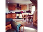 Beautiful open plan kitchen with AGA stove