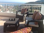 Relax on the upper terrace with stunning views of the bay
