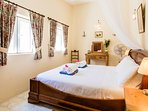 Airy bedroom One,  comfortable king size bed, blackout curtains, fitted wardrobe and cabinets.