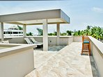 Rooftop lounge offers full-sun, full-shade, sun loungers and bar stools.