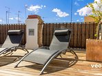 There are 2 deck chairs to relax by the sun, after refreshing in the pool.