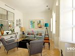 Stylish bright living room with original artwork and contemporary design furniture.