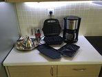 Breakfast bar Waffle iron toasts and grills. Stove-top espresso maker, tea set & filtered coffemaker