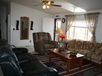 Beautiful Southwest Living Room with 3 Recliners and Couch.