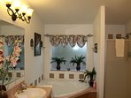 Master Bathroom En-Suite large soaking tub, walk-in shower and dual sinks and toilet. Sunny rooms