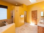 Private master bathroom with double sink, jetted tub and shower