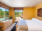 Bedroom #3 with comfortable king bed and direct access to pool