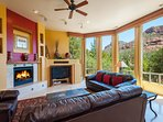 Living room with big screen TV, gas fire pit and views