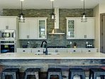 Gigantic Kitchen with Top of the Line Appliances