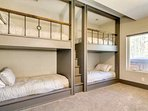Cozy bunk room downstairs with 2 sets of stunning built-in bunks